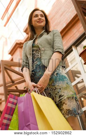 Young woman at shopping mall with shopping bags