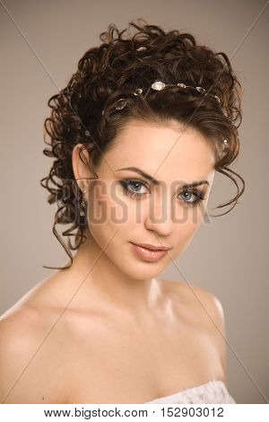 Young beautiful smiling bride with modern hairstyle  studio shoot