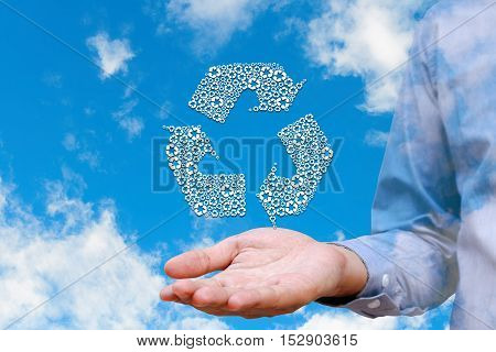 Man holding recycled icons on nature sky background Environment concept.
