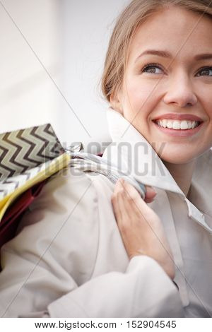 happy young woman holding shopping bags and smiling.Close up.Selective focus