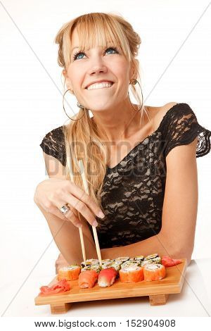Young woman with chopsticks and sushi studio shoot