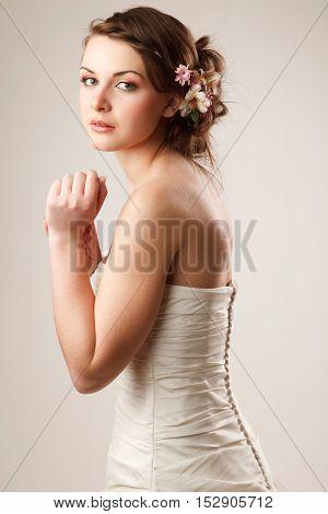 Charming sensual bride looking at camera studio shoot