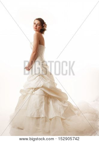 Standing bride looking at camera studio shoot