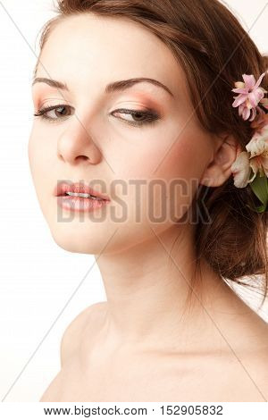 Gourgeus classical bride is looking down.Modern hairstyle with flowers
