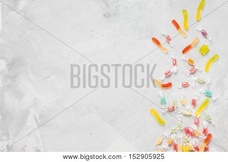 Candies on gray concrete background horizontal orientation