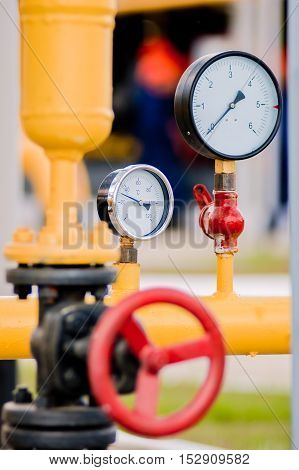 Closeup Of Pressure Meter With Red Faucet