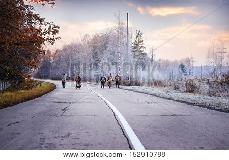 RUSSIA - NOVEMBER 11 2015: Unidentified fishermen go on a winter morning on the way to a fishing trip November 11 2015 in Russian