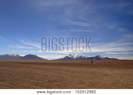 Lonely man in the dessert, altiplano, Bolivia