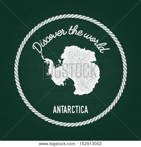 White Chalk Texture Vintage Insignia With Antarctica Map On A Green Blackboard. Grunge Rubber Seal W