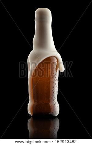 Suds Getting Out of an Overflowing Beer Bottle