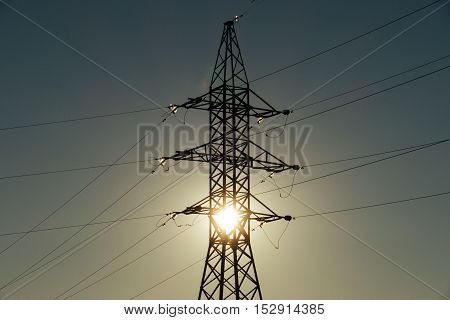 beautiful landscape with high voltage pylons and power lines at the setting sun. Russia, 2106.