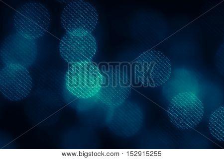 Bokeh dark blue mesh circles on black background. Abstract music background.