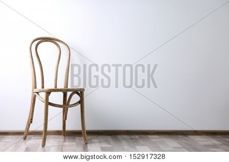 Simple interior with stool on white wall background