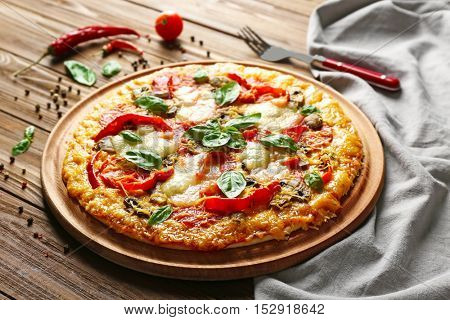 Tasty pizza on wooden table