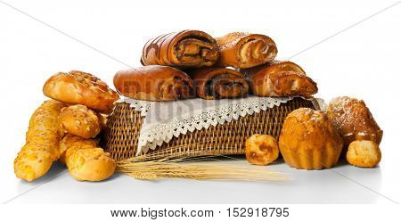 Assortment of fresh pastries in wicker bowl isolated on white