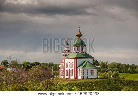 View of the Church of Elijah the Prophet on Ivanova mountain or Elias Church before the storm in Suzdal Russia. Golden Ring of Russia.