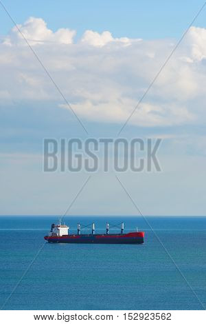 Dry Cargo Ship in the Black Seanear