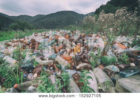plastic garbage on mountains closeup, toned like Instagram filter