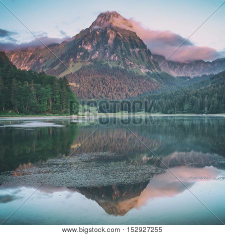 Amazing summer morning on the fantastic Swiss lake Obersee, located near Nafels village. Alps, Switzerland, Europe. Toned like Instagram filter
