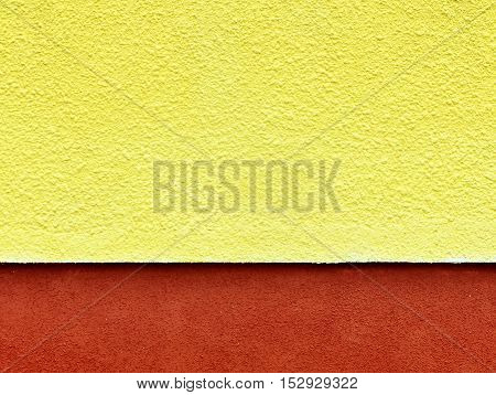 Architectural background. Yellow plaster wall texture with dark red stripe at the bottom. Place for an inscription.