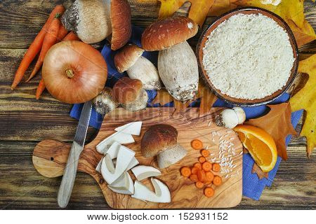Cooking italian risotto with wild mushrooms boletus