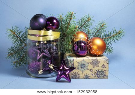 card with Christmas tree toys on a blue background