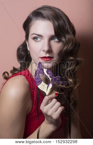 Beautiful Woman Holdind A Carnival Mask. Halloween Holiday Concept.