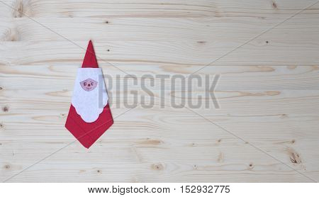 Santa claus serviette on wood, spruce, fir