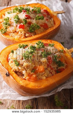 Half Baked Pumpkin With Couscous, Meat, Vegetables And Cheese Close-up. Vertical