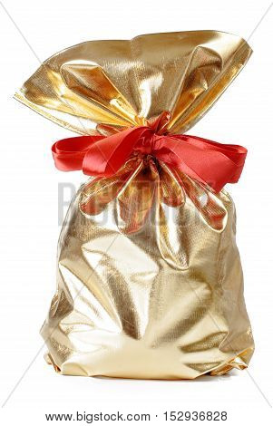 golden gift bag with a red bow on a white background