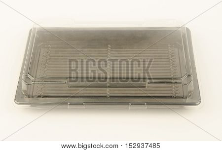Plastic containers for food. The transparent lid and black bottom. Horizontal photo. From above