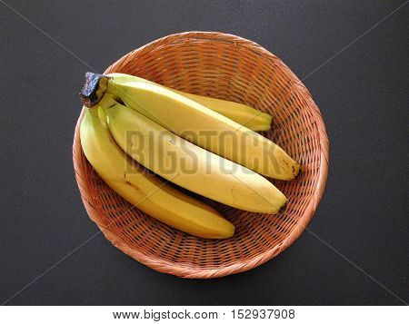 bananas to eat on a black background