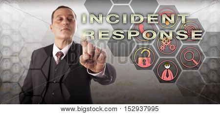 Experienced cyber crime investigator with confident facial expression is touching INCIDENT RESPONSE onscreen. Information technology concept for data breaches incident detection and management.