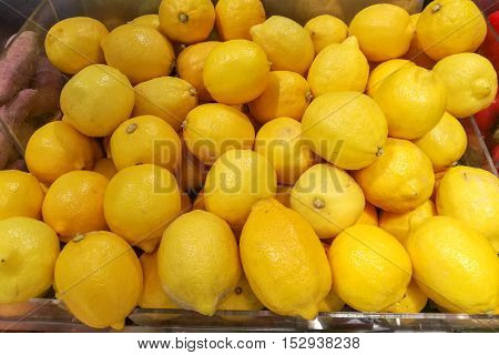 Fresh yellow lemons in the vegetables market.