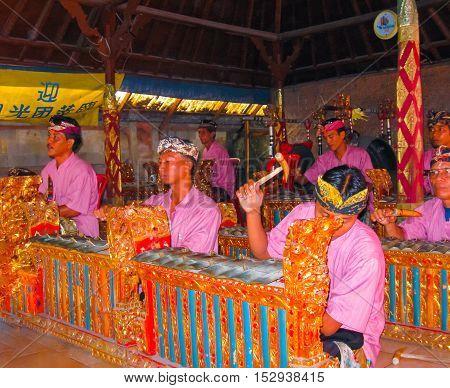 Sukawati Bali Indonesia - December 28 2008: Traditional Balinese musicians playing at music instrument gamelan
