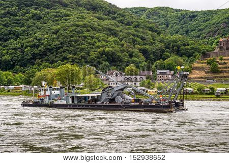 Trechtingshausen Germany - May 23 2016: Service vessel Carl Straat on the Rhine River near Trechtingshausen in cloudy weather Rhine Valley UNESCO World Heritage Site Rhineland-Palatinate Germany. Service vessel Carl Straat has a diving bell allowing to wa