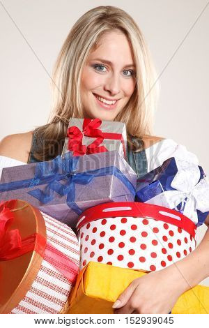 Young charming woman holding a lots of presents