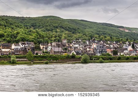 Trechtingshausen Germany - May 23 2016: Trechtingshausen village in the Unesco World Heritage area of the Rhine Valley in cloudy weather at the Mainz-Bingen district in Rhineland-Palatinate Germany.