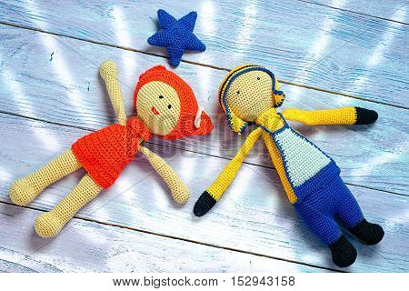 The Concept Of A Happy Couple - Knitted Toys Girl And Boy Lay Under The Stars Holding Hands. Painted