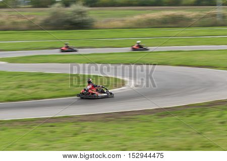 Super kart racing team. The racer on carting. Three Races on cartings. Races on a cross-country terrain. Cars races. Races on long exposure.