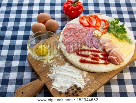 Background food. Preparation of the test. Ingredients for baking pizza,bacon,peppers,onions