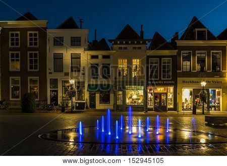 Zierikzee The Netherlands - October 5 2016: Houses and shops at night at the Havenplein in Zierikzee in Zeeland The Netherlands.