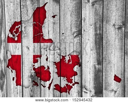 Map and flag of Denmark on weathered wood