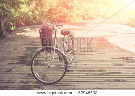 Vintage Bicycle on wooden bridge for travel