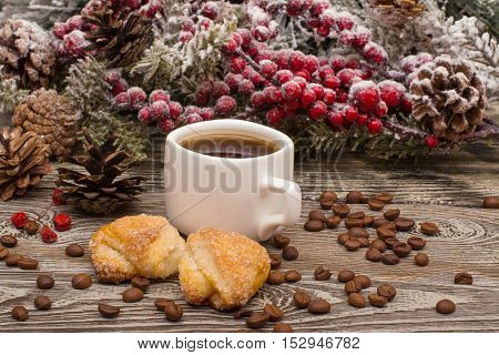 Cup Of Coffee, Cookies, Beans, Fir Branch In Snow On Wooden Background