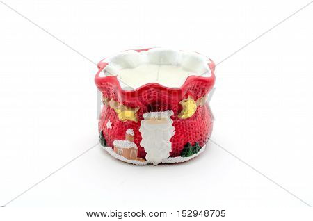 A red Christmas candle with Santa Claus on a white background.