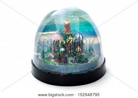 Snow-globe with Moscow St.Basil cathedral on a white background.