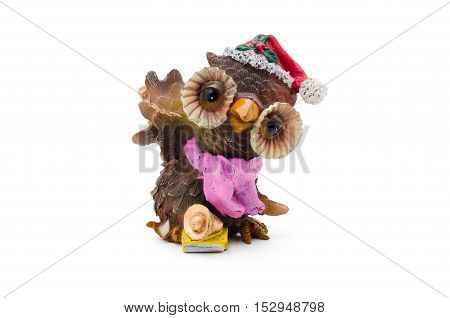 Christmas owl figurine in the red hat Isolated on white background.
