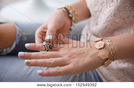 Female hands with bijouterie, close up