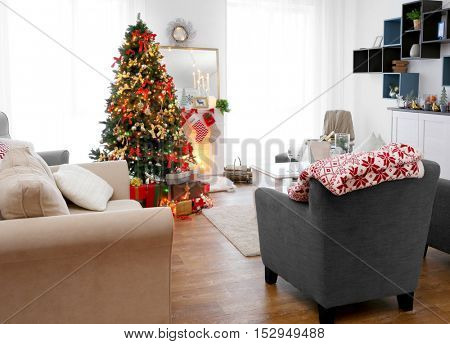 Cozy Christmas interior of living room with beautiful fir tree